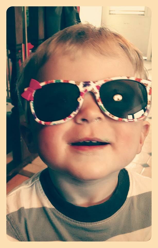 Happiness is little boys in flower sunglasses.